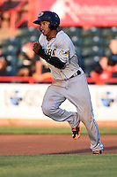 Akron RubberDucks shortstop Francisco Lindor (12) on the base paths during a game against the Erie SeaWolves on May 17, 2014 at Jerry Uht Park in Erie, Pennsylvania.  Erie defeated Akron 2-1.  (Mike Janes/Four Seam Images)