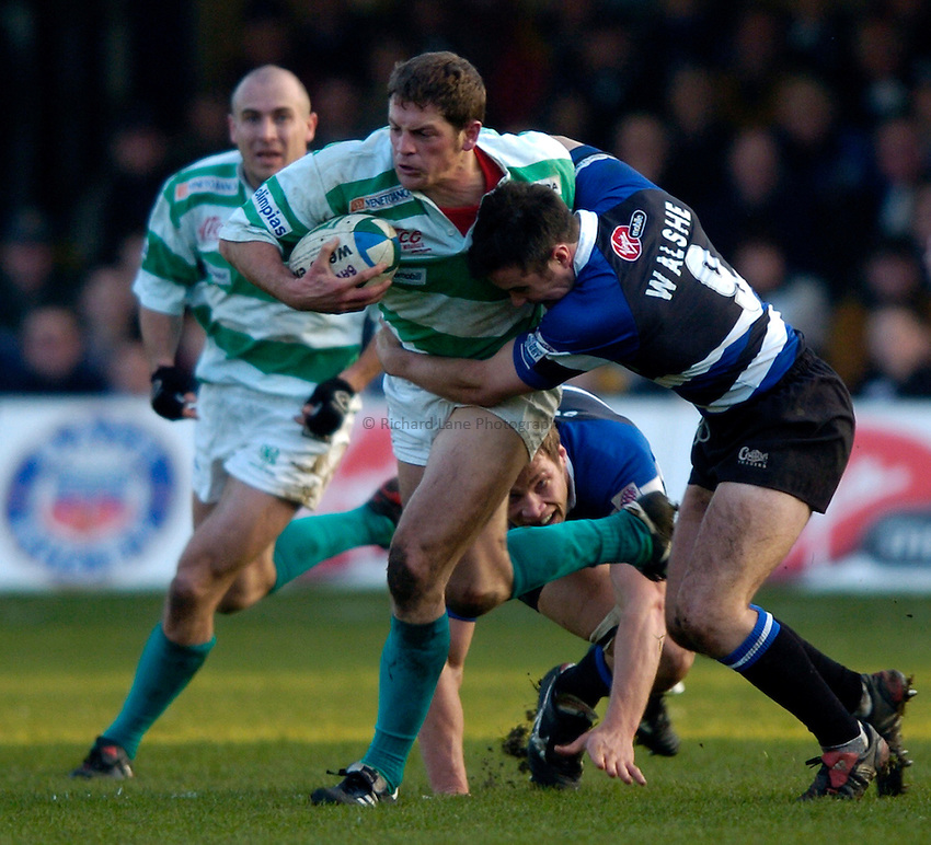 Photo: Richard Lane..Bath Rugby v Benetton Treviso. Heineken Cup. 11/12/2004..Walter Pozzebon is tackled by Nick Walshe.