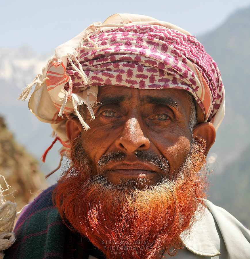 Bakarwal tribal sheep herder, with bright, henna red colored beard, Kashmir, India
