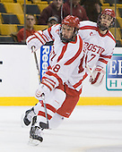 Wade Megan (BU - 18), Max Nicastro (BU - 7) - The Harvard University Crimson defeated the Boston University Terriers 5-4 in the 2011 Beanpot consolation game on Monday, February 14, 2011, at TD Garden in Boston, Massachusetts.