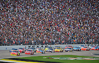 Nov. 8, 2009; Fort Worth, TX, USA; NASCAR Sprint Cup Series driver Jeff Gordon (24) leads the field during the Dickies 500 at the Texas Motor Speedway. Mandatory Credit: Mark J. Rebilas-