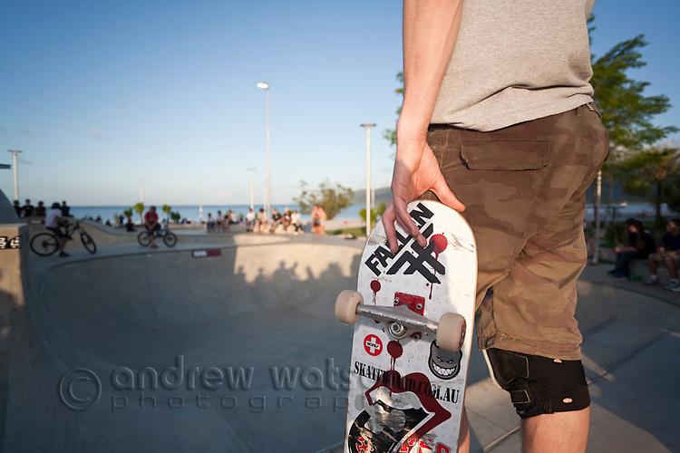 Skateboarder at urban skate park.  Cairns, Queensland, Australia