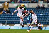 Joe McNerney of Crawley Town clears from Paris Cowan-Hall of Wycombe Wanderers during the Sky Bet League 2 match between Wycombe Wanderers and Crawley Town at Adams Park, High Wycombe, England on 25 February 2017. Photo by Andy Rowland / PRiME Media Images.