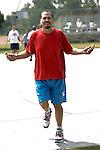 Mature hispanic man skipping rope