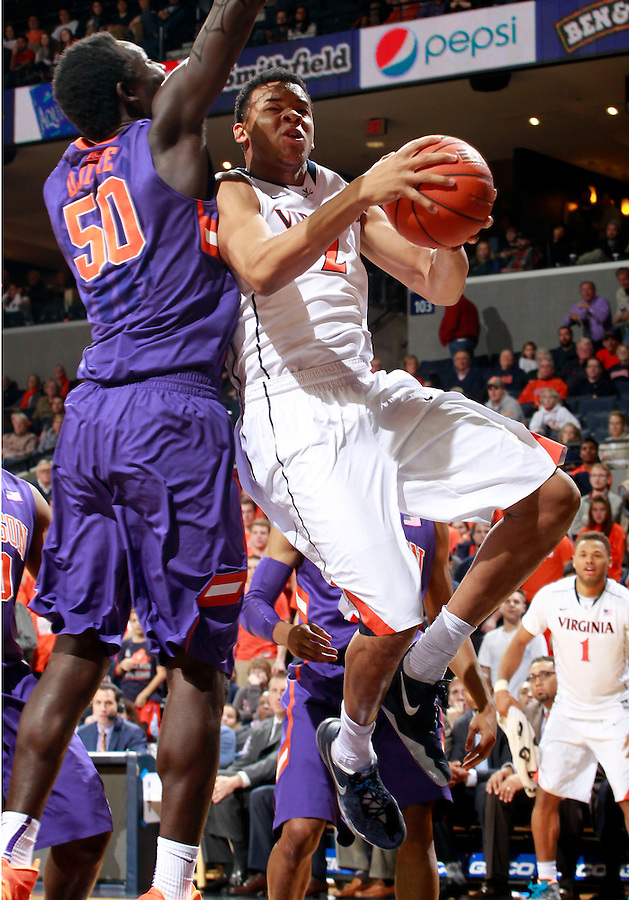 Virginia guard B.J. Stith (2) is fouled by Clemson center Sidy Djitte (50) during an ACC basketball game Jan. 13, 2015 in Charlottesville, VA Virginia won 65-42.