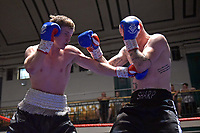Jake Anthony (white waistband) defeats Darryl Sharp during a Boxing Show at York Hall on 30th June 2018