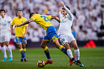 Marco Asensio Willemsen of Real Madrid (R) fights for the ball with Victor Machin Perez of UD Las Palmas (L) during the La Liga 2017-18 match between Real Madrid and UD Las Palmas at Estadio Santiago Bernabeu on November 05 2017 in Madrid, Spain. Photo by Diego Gonzalez / Power Sport Images
