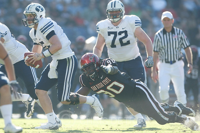 Photo by Chris Detrick  |  The Salt Lake Tribune .Brigham Young's Max Hall #15 runs past San Diego State's B.J. Williams #90 during the first half of the game at Qualcomm Stadium Saturday October 17, 2009. BYU is winning the game 21-14.