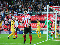 Lincoln City's Matt Rhead reacts after a chance wasn't converted in the second half<br /> <br /> Photographer Chris Vaughan/CameraSport<br /> <br /> The EFL Sky Bet League Two - Lincoln City v Morecambe - Saturday August 12th 2017 - Sincil Bank - Lincoln<br /> <br /> World Copyright &copy; 2017 CameraSport. All rights reserved. 43 Linden Ave. Countesthorpe. Leicester. England. LE8 5PG - Tel: +44 (0) 116 277 4147 - admin@camerasport.com - www.camerasport.com