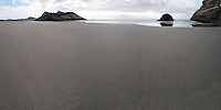 Panoramic Photo of Deserted Wharariki Beach, Golden Bay, South Island, New Zealand. This panoramic photo shows Wharariki Beach, a remarkable, remote, deserted beach, weathered by strong, driving winds located in the north of South Island, New Zealand in the Golden Bay Area.