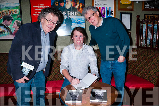 "Book Launch : Brian Devaney, Liselton signing copies of his book ""Social, Cultural & Phychological Resonance in John B. Keane"" at John B. Keane's Bar, Listowel on Thursday night last with Gabriel Fitzmaurice & Billy Keane."
