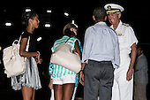 United States President Barack Obama, and daughters Malia (L) and Sasha (C) are greeted by PACOM Commander Admiral Sam Locklear and his wife Pam Locklear before boarding Air Force One on January 4, 2014 at Joint Base Pearl Harbor-Hickam in Honolulu, Hawaii. The President and daughters Sasha and Malia are returning to Washington, DC from Hawaii where they spent the winter holiday, the First Lady is remaining in Hawaii.<br /> Credit: Kent Nishimura / Pool via CNP