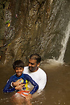 dad and son in waterfall in Costa Rica
