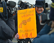 January 26, 2013  (Washington, DC)  A man holds an anti-NRA sign during the March on Washington for Gun Control.  (Photo by Don Baxter/Media Images International)
