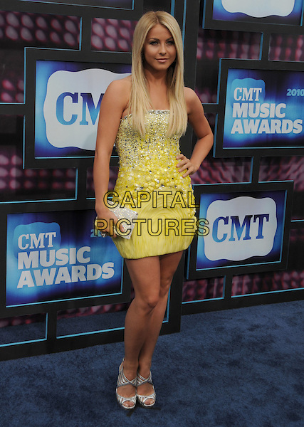 JULIANNE HOUGH .2010 CMT Music Awards held at Bridgestone Arena, Nashville, TN, USA, .9th June 2010.country music arrivals full length strapless yellow dress hand on hip white beaded silver shoes sandals clutch bag .CAP/ADM/LF.©Laura Farr/AdMedia/Capital Pictures.