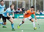 WASSENAAR - Hoofdklasse hockey heren, HGC-Bloemendaal (0-5)  Jamie Dwyer (Bldaal) met Siem Schoenaker (HGC)      COPYRIGHT KOEN SUYK