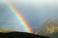 A Rainbow over the mountains of Chugach Natoinal Forest as seen from Seward, Alaska
