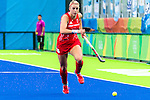 Hannah Macleod #6 of Great Britain chases the ball during  Argentina vs Great Britain in women's Pool B game  at the Rio 2016 Olympics at the Olympic Hockey Centre in Rio de Janeiro, Brazil.