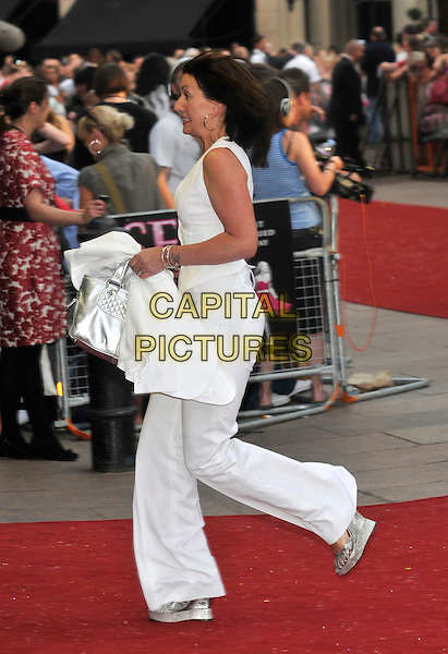 """DAVINA McCALL.Red Carpet Arrivals at the """"Sex And The City"""" Movie World Premiere, Odeon Leicester Square, London, England, UK,.May 12th 2008..full length white trousers funny running silver wedges .CAP/PL.©Phil Loftus/Capital Pictures"""