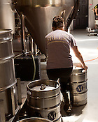 August 7, 2013. Hillsborough, North Carolina.<br />  Kimi Cook fills kegs for distribution.<br />  Mystery Brewing Co. is just one of several new breweries to open up in Orange County over the last year. With a taproom just up the road, Mystery has become increasingly popular as the craft beer market in North Carolina grows.
