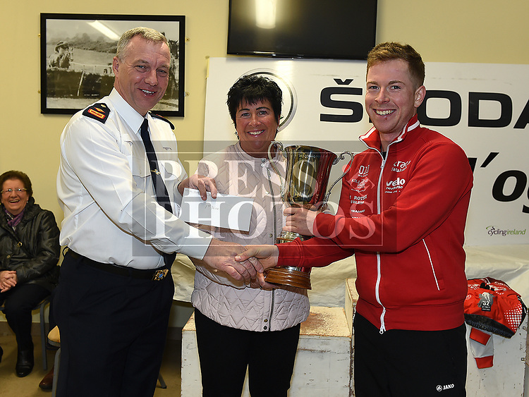 Chairperson of Drogheda Wheelers Superintendent Andrew Watters and Linda Dunne daughter of the late Paddy Coombes presents  Philip Lavery from Strata 3 cycling with the Coombes Connor Memorial race Trophy. Photo:Colin Bell/pressphotos.ie