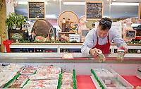 Owner Artie Elias, surveys the oysters at his butcher Shop in Roanoke Rapids, North Carolina.