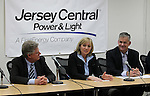 Jersey Central Power & Light President James V. Fakult (R) briefs the media with Congressman Frank Pallone, Jr. (L), Acting Governor Kim Guadango (C) on Winter Storm Jonas preparations in Union Beach, New Jersey on Friday January 22, 2016.