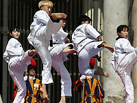 Alcuni giovani atleti di Taekwondo provenienti dalla Corea del Sud eseguono una performance atletica durante l'udienza generale del mercoledi' in Piazza San Pietro, Citta' del Vaticano, 30 maggio, 2018.<br /> Taekwondo athletes  from South Korea perform during his weekly general audience in St. Peter's Square, at the Vatican, on May 30, 2018.<br /> UPDATE IMAGES PRESS/IsabellaBonotto<br /> <br /> STRICTLY ONLY FOR EDITORIAL USE