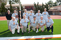 Occidental College class of 1960 football team alumni pose in the end zone of Patterson Field.<br /> Homecoming festivities, November 6, 2010. (Photo by Marc Campos, Occidental College Photographer)