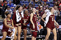 GREENSBORO, NC - MARCH 06: Milan Bolden-Morris #23, Clara Ford #32, Sydney Lowery #31, Cameron Swarz #1, and Georgia Pineau #5 of Boston College celebrate on the bench during a game between Boston College and Duke at Greensboro Coliseum on March 06, 2020 in Greensboro, North Carolina.