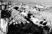 BNPS.co.uk (01202 558833)<br /> NARA/BNPS<br /> <br /> RAMC personnel and wounded British Soldiers take cover in a trench. <br /> <br /> Remarkable rarely seen photos of heroic Allied soldiers fighting their way across Europe before crossing the River Rhine 75 years ago feature in a new book.<br /> <br /> They are published in Images of War, Montgomery's Rhine Crossing, which tells the story of the legendary offensive, nicknamed Operation Plunder, in March 1945.<br /> <br /> On the night of March 23, Field Marshal Bernard Montgomery's 21st Army Group launched a massive artillery, amphibious and airborne assault to breach the historic defensive water barrier protecting northern Germany.<br /> <br /> At the same time, the Americans, with the support of the British 6th Airborne Division, set in motion Operation Varsity - involving 16,000 paratroopers - on the east bank of the Rhine. They were dropped here to seize bridges to prevent German reinforcements from contesting the bridgeheads.<br /> <br /> Fierce fighting ensued, with much bloodshed on both sides as the Allies met determined resistance from machine gun nests. But the daring operation proved successful, helping to considerably shorten the war - the Nazis surrendered just six weeks later.