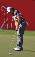Rory McIlroy (NIR) sinks his putt to clinch 2nd place on the 18th hole during Sunday's Final Round of the HSBC Golf Championship at the Abu Dhabi Golf Club, United Arab Emirates, 29th January 2012 (Photo Eoin Clarke/www.golffile.ie)
