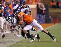 Oct 23, 2010; Charlottesville, VA, USA; Virginia Cavaliers linebacker Ausar Walcott (26) tackles Eastern Michigan Eagles wide receiver Tyrone Burke (9) during the game at Scott Stadium.  Virginia won 48-21. Mandatory Credit: Andrew Shurtleff