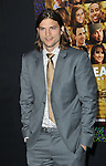 Ashton Kutcher arriving at the New Year's Eve premiere, held at Grauman's Chinese theater December 5, 2011.