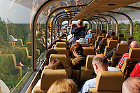 Tourists enjoy panoramic views aboard a double decker train car on the Alaska Railroad system, Alaska