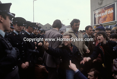 Belfast The Troubles. 1980s. Catholic protesters torment RUC Royal Ulster Constabulary Police 1981 Central Belfast.