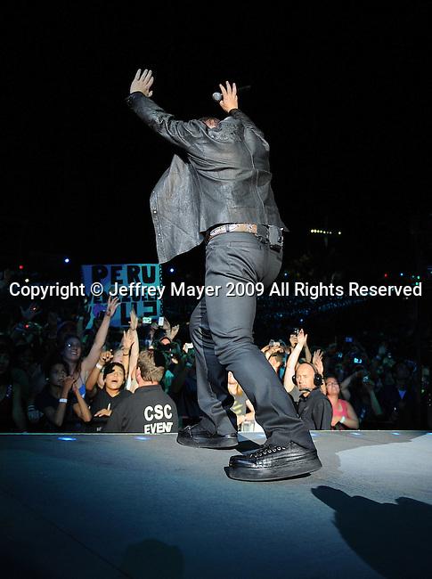 PASADENA, CA. - October 25: Bono of U2 performs in concert during their 360º Tour at the Rose Bowl on October 25, 2009 in Pasadena, California.
