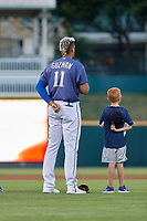Frisco RoughRiders Ronald Guzman (11) stands with a young fan during the national anthem before a Texas League game against the Springfield Cardinals on May 7, 2019 at Dr Pepper Ballpark in Frisco, Texas.  (Mike Augustin/Four Seam Images)