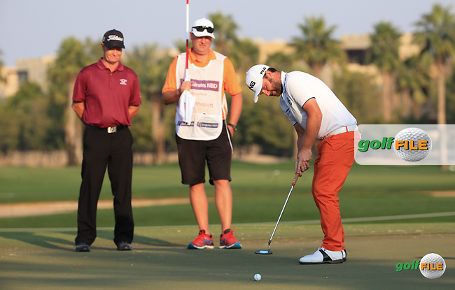 Jamie Gough and caddie Sean watch Andy Sullivan (ENG) putting during the Pro-Am at the 2016 Omega Dubai Desert Classic, played on the Emirates Golf Club, Dubai, United Arab Emirates.  03/02/2016. Picture: Golffile | David Lloyd<br /> <br /> All photos usage must carry mandatory copyright credit (&copy; Golffile | David Lloyd)