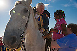 Mark Collins as General George Washington tells a young girl about his horse at the North Houston Tea Party Rally at Sam Houston Race Park.