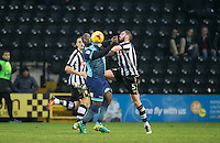Adebayo Akinfenwa of Wycombe Wanderers battles Richard Duffy of Notts Co during the Sky Bet League 2 match between Notts County and Wycombe Wanderers at Meadow Lane, Nottingham, England on 10 December 2016. Photo by Andy Rowland.