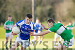 John Ferguson Kerins O'Rahilly's takes on Legions Alan Moriarty during their club championship clash in Derreen on Saturday evening