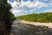 Looking up the East Branch of the Pemigewasset River from a viewpoint along the Lincoln Woods Trail in Lincoln, New Hampshire USA. Storm debris from Tropical Storm Irene can be seen along the riverbank. This tropical storm caused destruction along the East coast of the United States.