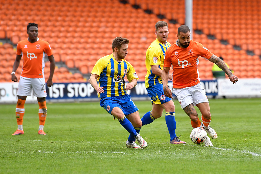 Blackpool's Kyle Vassell under pressure from Accrington Stanley's Jordan Clark<br /> <br /> Photographer Terry Donnelly/CameraSport<br /> <br /> The EFL Sky Bet League Two - Blackpool v Accrington Stanley - Friday 14th April 2017 - Bloomfield Road - Blackpool<br /> <br /> World Copyright &copy; 2017 CameraSport. All rights reserved. 43 Linden Ave. Countesthorpe. Leicester. England. LE8 5PG - Tel: +44 (0) 116 277 4147 - admin@camerasport.com - www.camerasport.com