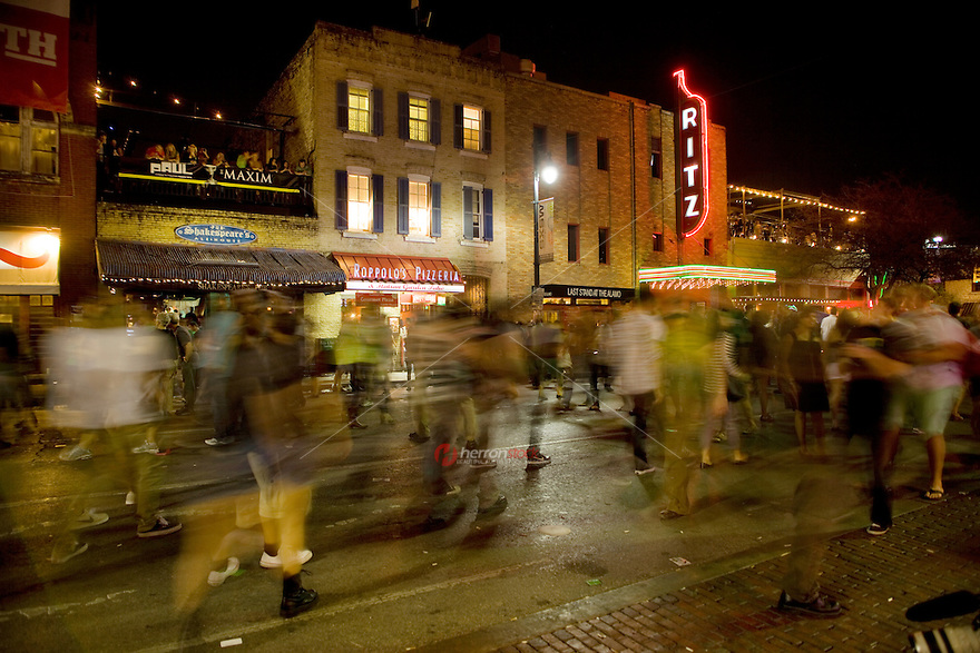 Crowds of people fill the street on 6th Street during the SXSW Music Festival