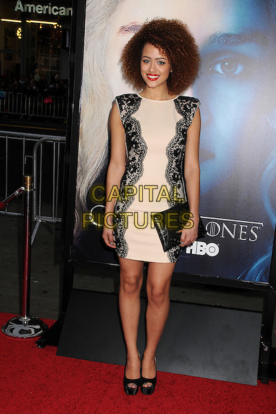 """Nathalie Emmanuel.""""Game Of Thrones"""" 3rd Season Los Angeles Premiere held at the TCL Chinese Theatre, Hollywood, California, USA..March 18th, 2013.full length dress clutch bag lace black beige sleeveless .CAP/ADM/BP.©Byron Purvis/AdMedia/Capital Pictures."""