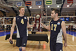 27 APR 2014: Alex McColgin (4) and Ben Krouse (17) of Juniata College accept the runner-up trophy during the Division III Men's Volleyball Championship held at the Kennedy Sports Center in Huntingdon, PA. Springfield defeated Juniata 3-0 to win the national title.  Mark Selders/NCAA Photos