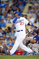 Matt Kemp #27 of the Los Angeles Dodgers bats against the Colorado Rockies at Dodger Stadium on September 29, 2012 in Los Angeles, California. Los Angeles defeated Colorado 3-0. (Larry Goren/Four Seam Images)