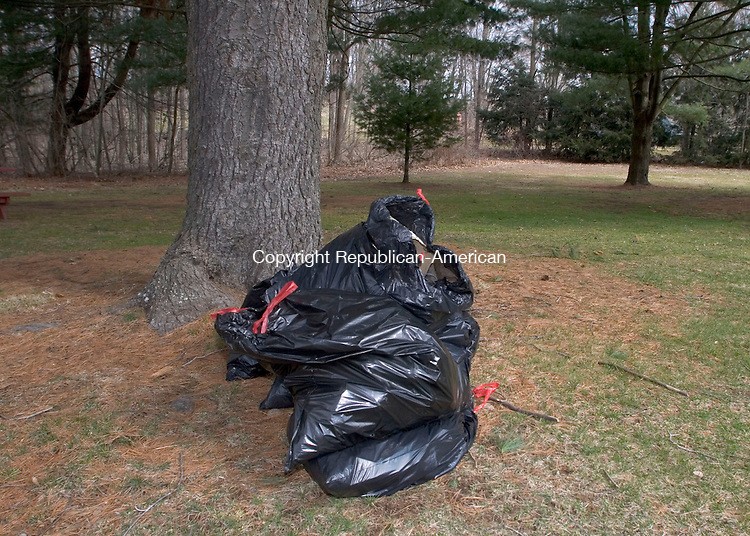 WOODBURY, CT - 07 APRIL 2007 - 040707JW12.jpg -- Plastic bags filled with trash start piling up at Hollow Park during the town of Woodburys annual spring townwide cleanup Saturday morning. Jonathan Wilcox Republican-American