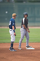 Grand Junction Rockies third baseman Coco Montes (19) talks to Helena Brewers shortstop Brice Turang (18) during a Pioneer League game against the Helena Brewers at Kindrick Legion Field on August 19, 2018 in Helena, Montana. The Grand Junction Rockies defeated the Helena Brewers by a score of 6-1. (Zachary Lucy/Four Seam Images)